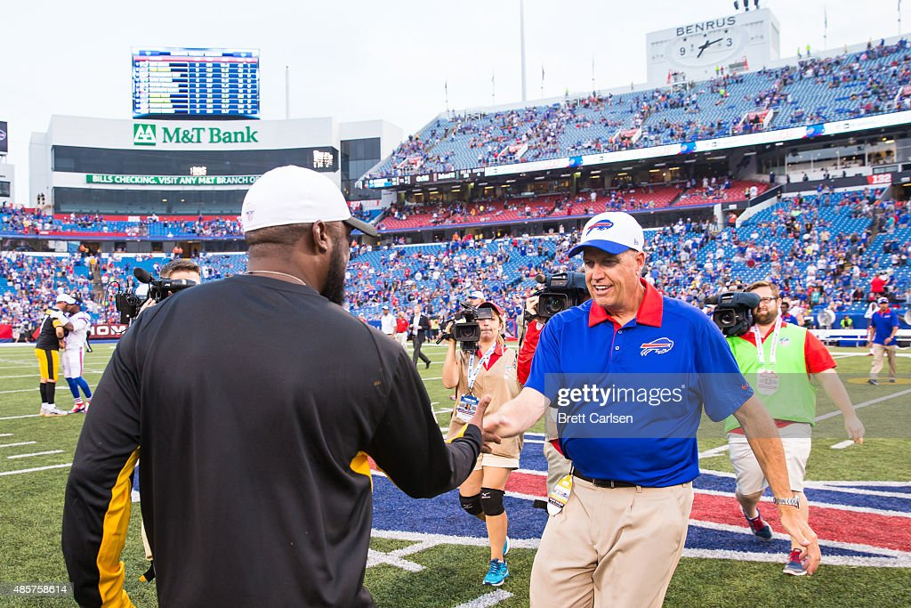 Head coach Mike Tomlin of the Pittsburgh Steelers shakes the hand of head coach Rex Ryan of the Buffalo Bills after a preseason game on August 29, 2015 at Ralph Wilson Stadium in Orchard Park, New York. Buffalo defeats Pittsburgh 43-19.