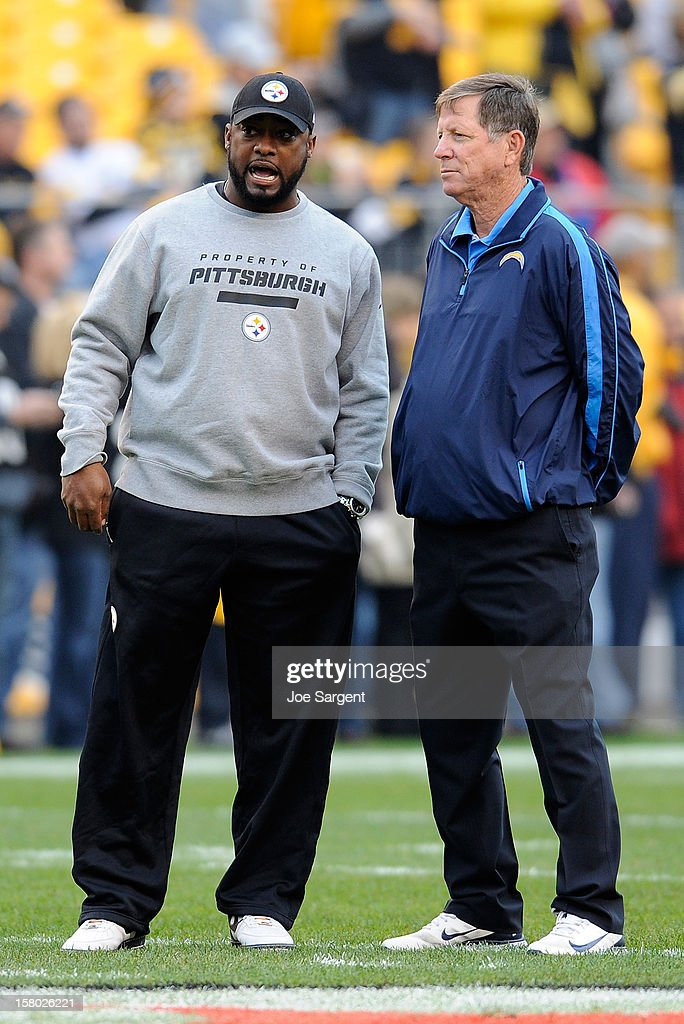 Head Coach Mike Tomlin of the Pittsburgh Steelers talks with head coach Norv Turner of the San Diego Chargers prior to the game on December 9, 2012 at Heinz Field in Pittsburgh, Pennsylvania.