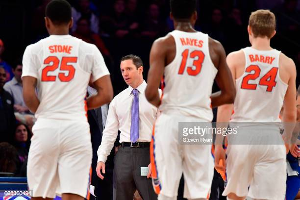Head coach Mike White of the Florida Gators speaks with his team during a timeout against the South Carolina Gamecocks during the first half of the...