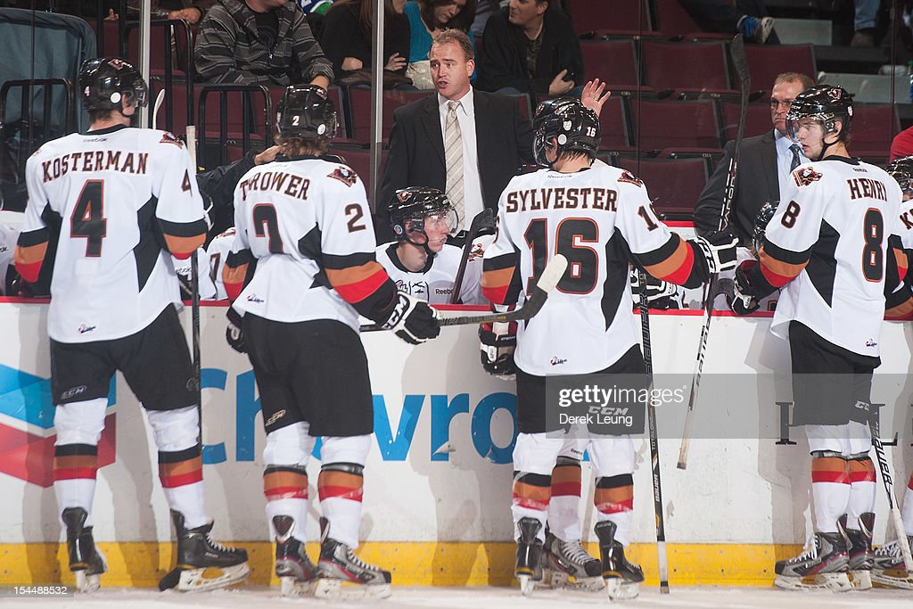Head coach Mike Williamson of the Calgary Hitmen speaks to his team during a time out during the game against the Vancouver Giants in WHL action on October 20, 2012 at Pacific Coliseum in Vancouver, British Columbia, Canada.