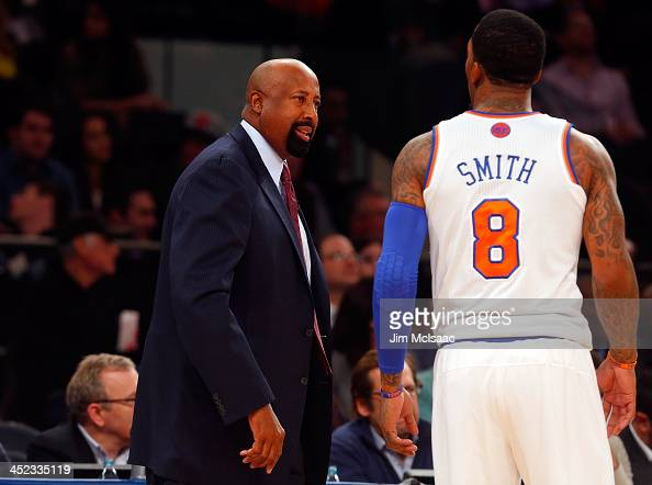 Head coach Mike Woodson and JR Smith of the New York Knicks in action against the Indiana Pacers at Madison Square Garden on November 20 2013 in New...