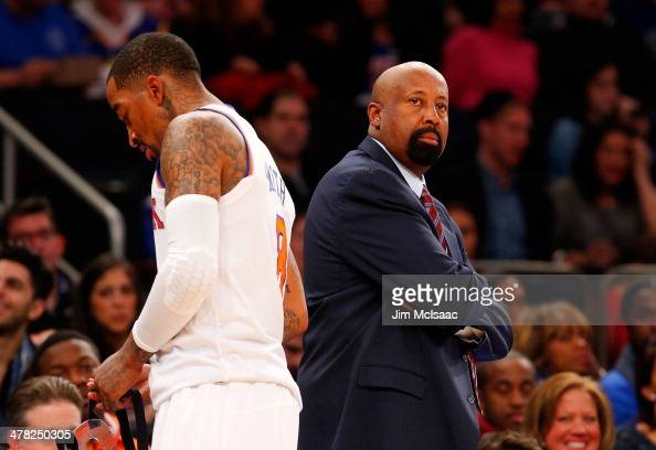Head coach Mike Woodson and JR Smith of the New York Knicks in action against the Golden State Warriors at Madison Square Garden on February 28 2014...