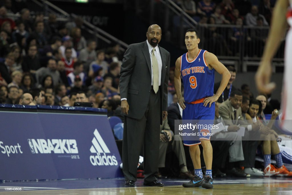 Head Coach Mike Woodson and Pablo Prigioni #9 of the New York Knicks talk things over during a game between the New York Knicks and the Detroit Pistons at the 02 Arena on January 17, 2013 in London, England.