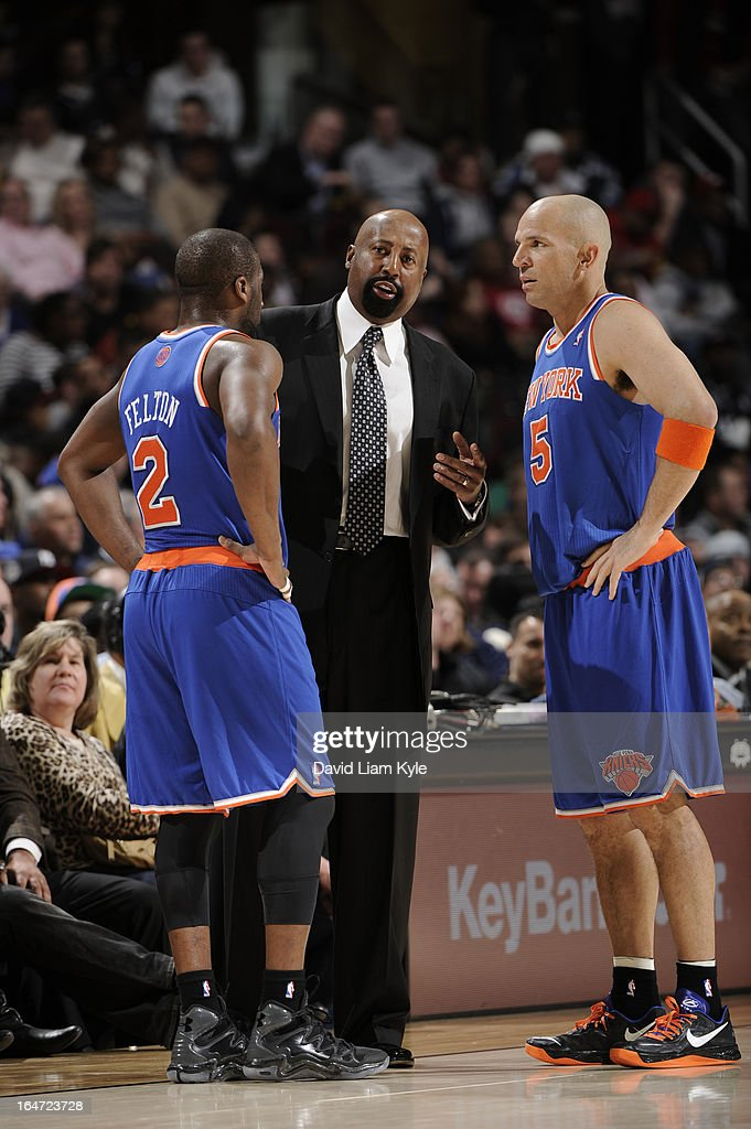 Head Coach Mike Woodson goes over the game plan with Raymond Felton #2 and Jason Kidd #5 of the New York Knicks against the Cleveland Cavaliers at The Quicken Loans Arena on March 4, 2013 in Cleveland, Ohio.