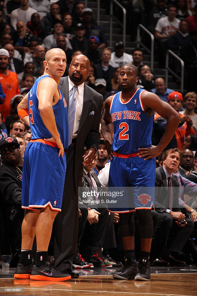 Head Coach Mike Woodson instructs players Jason Kidd #5 and Raymond Felton #2 of the New York Knicks on December 11, 2012 at the Barclays Center in the Brooklyn borough of New York City.