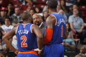 Head Coach Mike Woodson of the New York Knicks coaches his players Raymond Felton and Amar'e Stoudemire against the Sacramento Kings on March 26 2014...