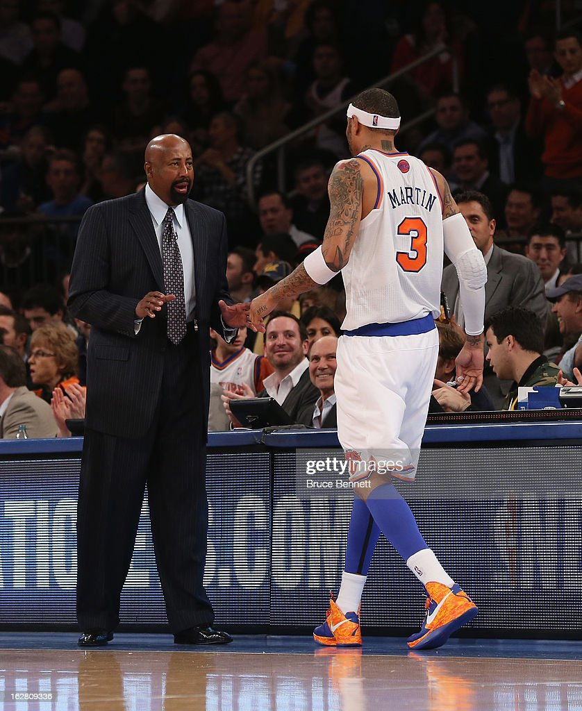 Head coach Mike Woodson of the New York Knicks greets Kenyon Martin #3 during the game against the Golden State Warriors at Madison Square Garden on February 27, 2013 in New York City.