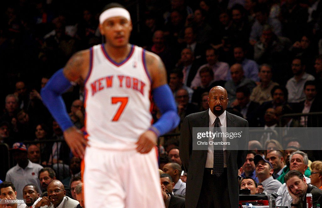 Head coach Mike Woodson of the New York Knicks looks on as Carmelo Anthony of the New York Knicks walks up court in the second half against the...