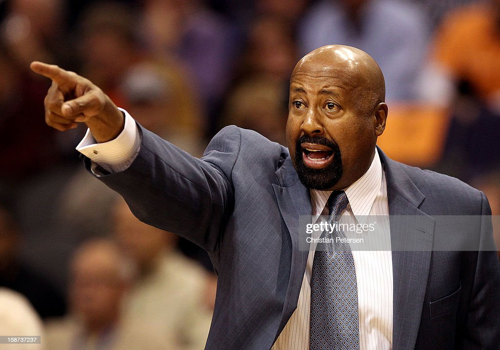 Head coach <a gi-track='captionPersonalityLinkClicked' href=/galleries/search?phrase=Mike+Woodson&family=editorial&specificpeople=213194 ng-click='$event.stopPropagation()'>Mike Woodson</a> of the New York Knicks reacts during the NBA game against the Phoenix Suns at US Airways Center on December 26, 2012 in Phoenix, Arizona. The Knicks defeated the Suns 99-97.