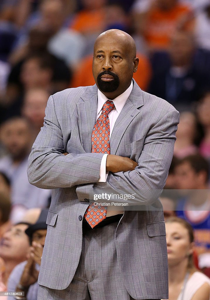 Head coach <a gi-track='captionPersonalityLinkClicked' href=/galleries/search?phrase=Mike+Woodson&family=editorial&specificpeople=213194 ng-click='$event.stopPropagation()'>Mike Woodson</a> of the New York Knicks reacts on the sidelines during the NBA game against the Phoenix Suns at US Airways Center on March 28, 2014 in Phoenix, Arizona. The Suns defeated the Knicks 112-88.