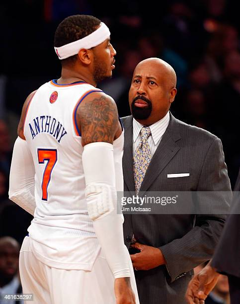 Head coach Mike Woodson of the New York Knicks talks to Carmelo Anthony during a game against the Atlanta Hawks at Madison Square Garden on December...