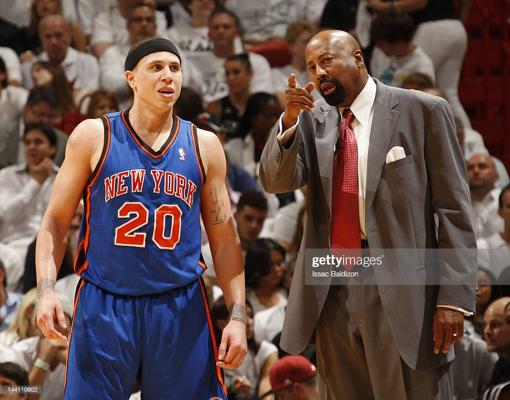 Head Coach Mike Woodson of the New York Knicks talks to Mike Bibby #20 in Game Five of the Eastern Conference Quarterfinals against the Miami Heat during the 2012 NBA Playoffs on May 9, 2012 at American Airlines Arena in Miami, Florida.