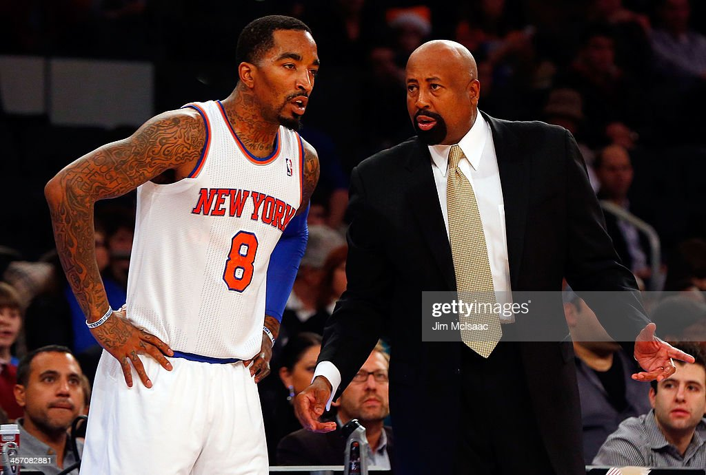 Head coach Mike Woodson of the New York Knicks talks with JR Smith during a game against the Orlando Magic at Madison Square Garden on December 6...