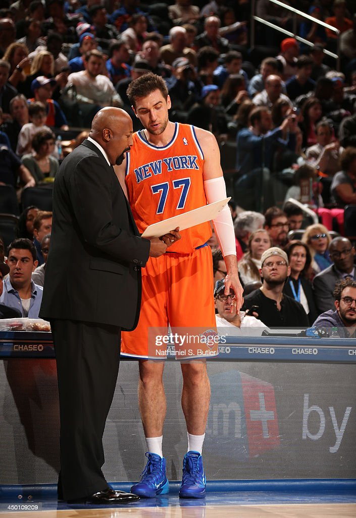 Head Coach Mike Woodson of the New York Knicks talks with player Andrea Bargnani #77 of the New York Knicks during a game at Madison Square Garden in New York City on November 16, 2013.