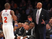 Head coach Mike Woodson of the New York Knicks talks with Raymond Felton during a game against the Miami Heat at Madison Square Garden on February 1...