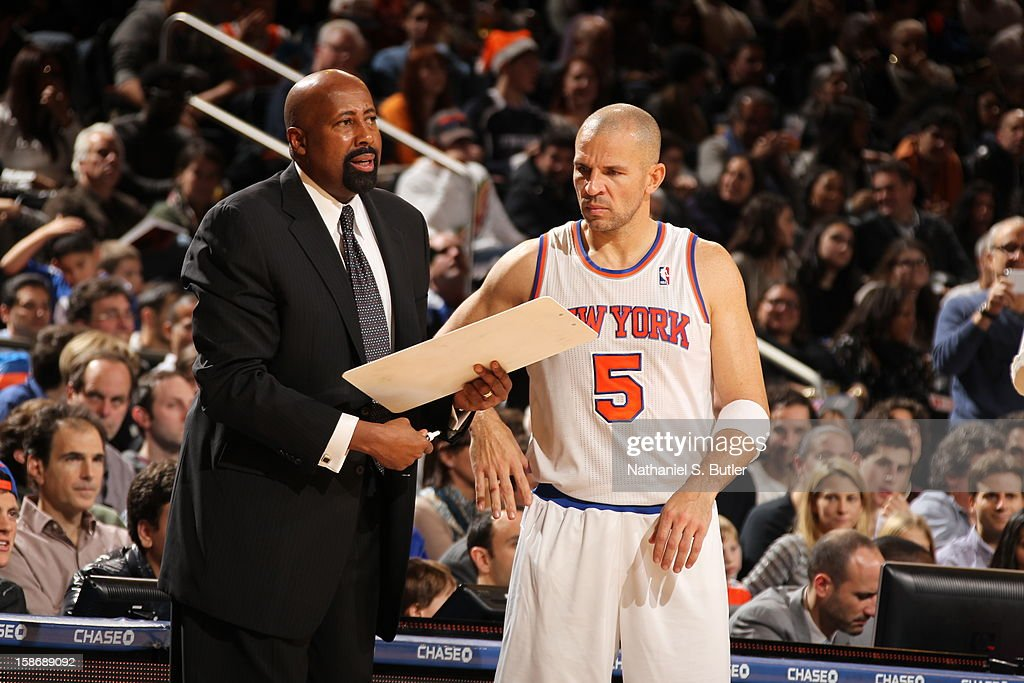 Head coach Mike Woodson speaks with Jason Kidd #5 of the New York Knicks during a game played against the Minnesota Timberwolves on December 23, 2012 at Madison Square Garden in New York City.