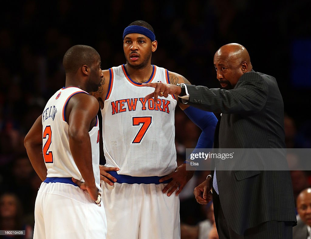 Head coach Mike Woodson talks with Raymond Felton #2 and Carmelo Anthony #7 of the New York Knicks during a time out against the Atlanta Hawks on January 27, 2013 at Madison Square Garden in New York City. The New York Knicks defeated the Atlanta Hawks 106-104.