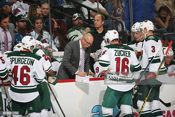 Head coach Mike Yeo of the Minnesota Wild directs his team against the Colorado Avalanche at the Pepsi Center on October 8 2015 in Denver Colorado...