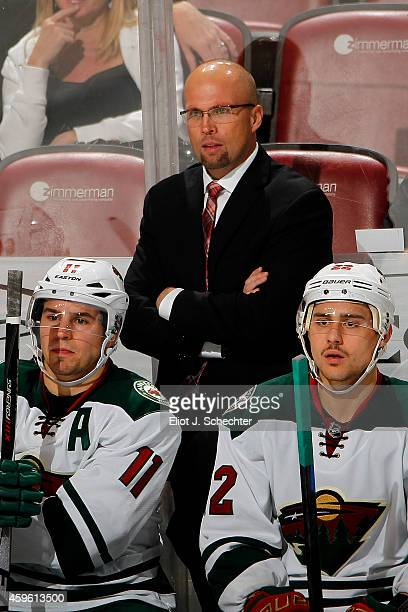 Head Coach Mike Yeo of the Minnesota Wild directs his team from the bench against the Florida Panthers at the BBT Center on November 24 2014 in...