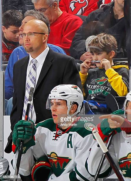 Head coach Mike Yeo of the Minnesota Wild looks on against the New Jersey Devils at the Prudential Center on March 20 2014 in Newark New Jersey