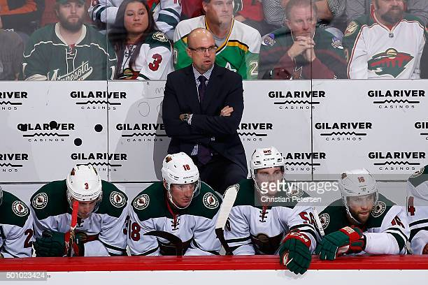 Head coach Mike Yeo of the Minnesota Wild looks on from the bench during the second period of the NHL game against the Arizona Coyotes at Gila River...