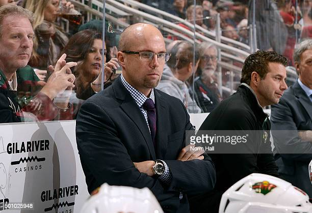Head coach Mike Yeo of the Minnesota Wild looks on from the bench during first period action against the Arizona Coyotes at Gila River Arena on...