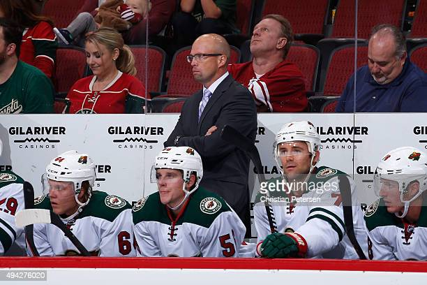 Head coach Mike Yeo of the Minnesota Wild on the bench during the NHL game against the Arizona Coyotes at Gila River Arena on October 15 2015 in...