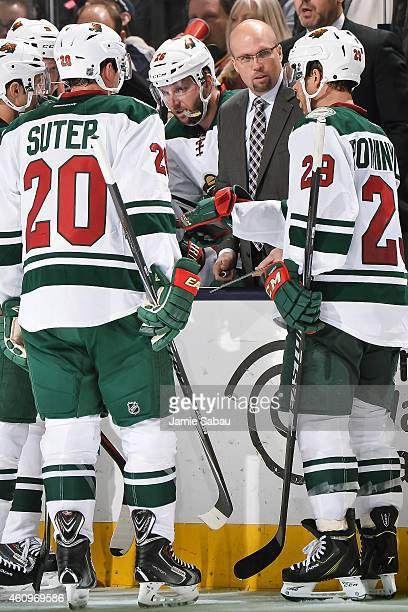 Head Coach Mike Yeo of the Minnesota Wild talks to his team during a timeout against the Columbus Blue Jackets on December 31 2014 at Nationwide...