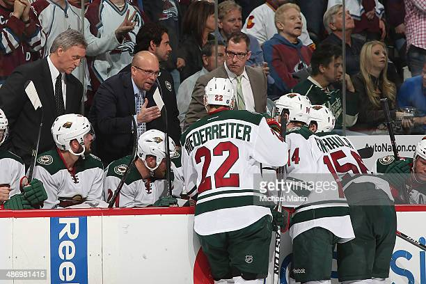 Head Coach Mike Yeo of the Minnesota Wild talks with Nino Niederreiter Justin Fontaine and Erik Haula during a time out in Game Five against the...