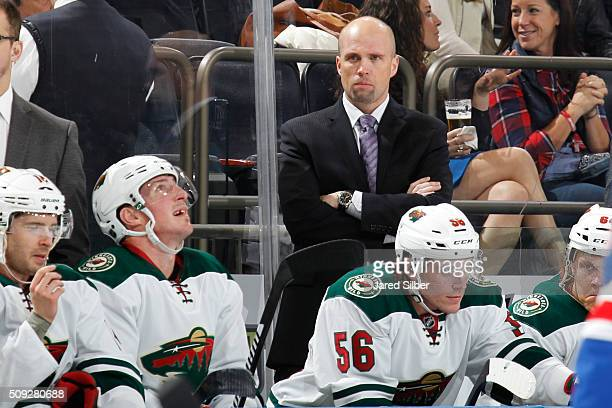 Head coach Mike Yeo of the Minnesota Wild watches the action from the bench during the game against the New York Rangers at Madison Square Garden on...