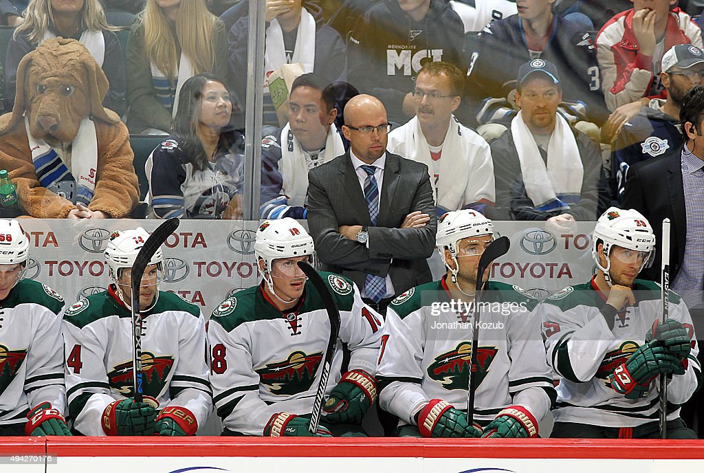Head Coach Mike Yeo of the Minnesota Wild watches third period action against the Winnipeg Jets from the bench at the MTS Centre on October 25, 2015 in Winnipeg, Manitoba, Canada.