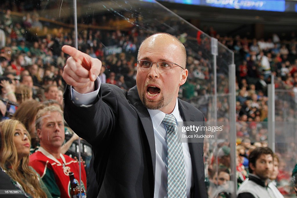 Head coach Mike Yeo of the Minnesota Wild yells at the Edmonton Oilers bench during the game on April 26, 2013 at the Xcel Energy Center in St. Paul, Minnesota.