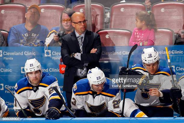 Head Coach Mike Yeo of the St Louis Blues keeps an eye on the action from the bench against the Florida Panthers at the BBT Center on April 6 2017 in...