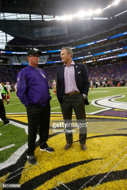 Head Coach Mike Zimmer of the Minnesota Vikings talks on the field with General Manager John Lynch of the San Francisco 49ers prior to the game at US...