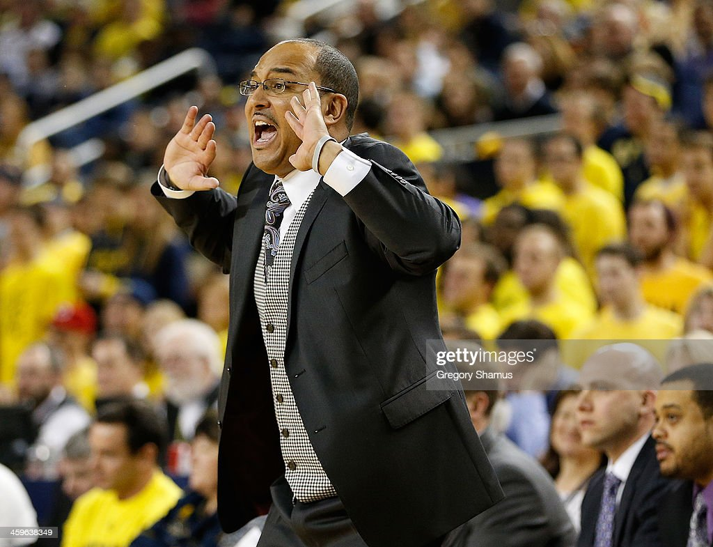 Head coach Milan Brown of the Holy Cross Crusaders yells from the bench while playing the Michigan Wolverines at Crisler Center on December 28, 2013 in Ann Arbor, Michigan. Michigan won the game 88-66.