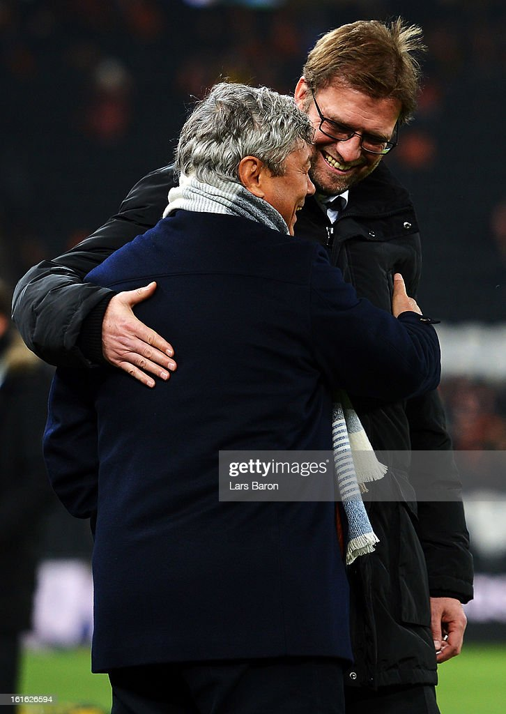 Head coach Mircea Lucescu of Donetsk speals with head coach Juergen Klopp of Dortmund prior to the UEFA Champions League Round of 16 first leg match between Shakhtar Donetsk and Borussia Dortmund at Donbass Arena on February 13, 2013 in Donetsk, Ukraine.