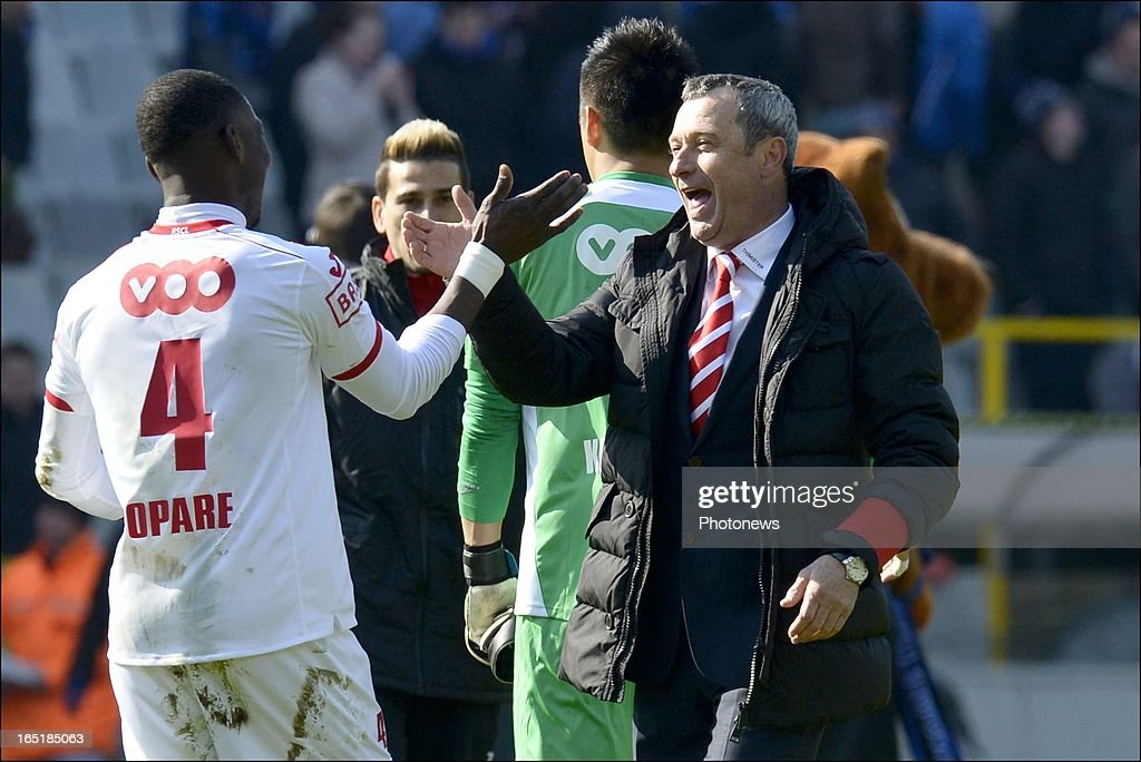 Head coach Mircea Rednic of Standard celebrates the victory with Daniel Opare of Standard after the Jupiler League match between Club Brugge and Standard de Liege on April 01, 2013 in the Jan Breydel Stadium in Brugge, Belgium.