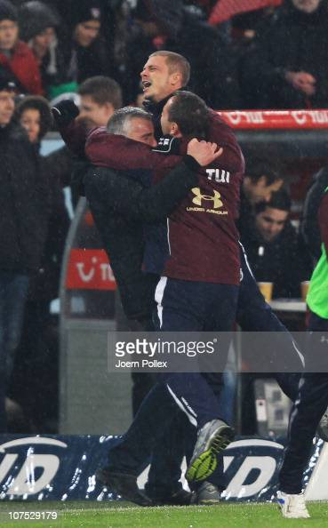 Head coach Mirko Slomka of Hannover 96 celebrates after the Bundesliga match between Hannover 96 and VfB Stuttgart at the AWD Arena on December 10...
