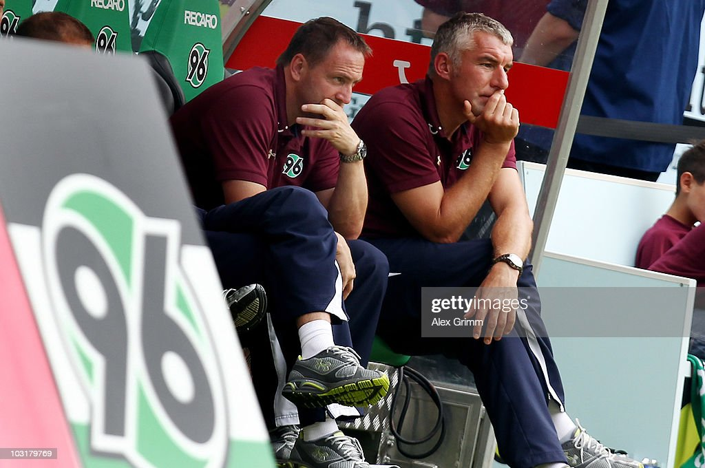 Head coach <a gi-track='captionPersonalityLinkClicked' href=/galleries/search?phrase=Mirko+Slomka&family=editorial&specificpeople=874525 ng-click='$event.stopPropagation()'>Mirko Slomka</a> (R) of Hannover and assistant coach Norbert Duewel react during the pre-season friendly match between Hannover 96 and Valencia CF at the AWD Arena on July 31, 2010 in Hanover, Germany.