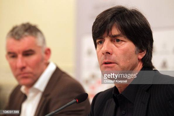 Head coach Mirko Slomka of Hannover and national coach Joachim Loew of Germany attend the press conference at KempinskiHotel Gravenbruch on January...