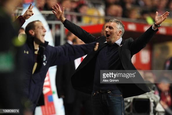 Head coach Mirko Slomka of Hannover celebrates after the Bundesliga match between FSV Mainz 05 and Hannover 96 at the Bruchweg Stadium on November 13...