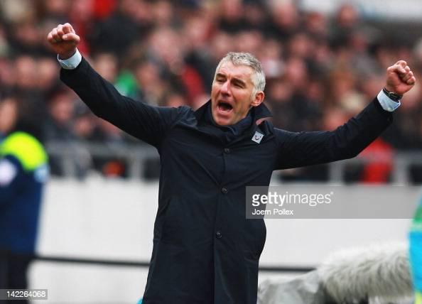 Head coach Mirko Slomka of Hannover celebrates after the Bundesliga match between Hanover 96 and Borussia Moenchengladbach at AWD Arena on April 1...
