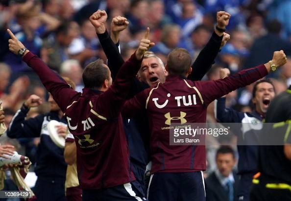 Head coach Mirko Slomka of Hannover celebrates after winning the Bundesliga match between FC Schalke 04 and Hannover 96 at Veltins Arena on August 28...