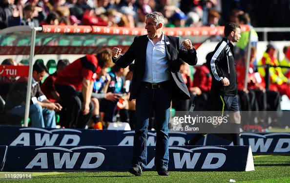 Head coach Mirko Slomka of Hannover celebrates after winning the Bundesliga match between Hannover 96 and FSV Mainz 05 at AWD Arena on April 9 2011...
