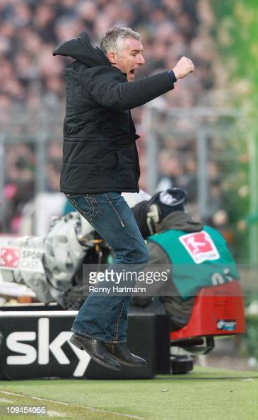 Head coach Mirko Slomka of Hannover celebrates his teams first goal during the Bundesliga match between FC St Pauli and Hannover 96 at the Millerntor...