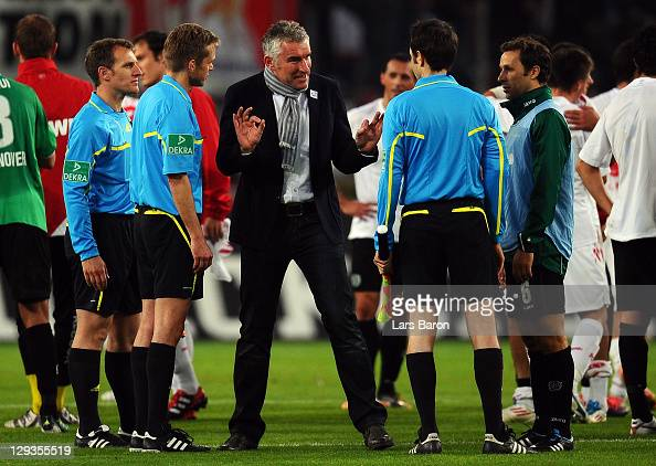 Head coach Mirko Slomka of Hannover discusses with referee Jochen Drees after loosing the Bundesliga match between 1 FC Koeln and Hannover 96 at...