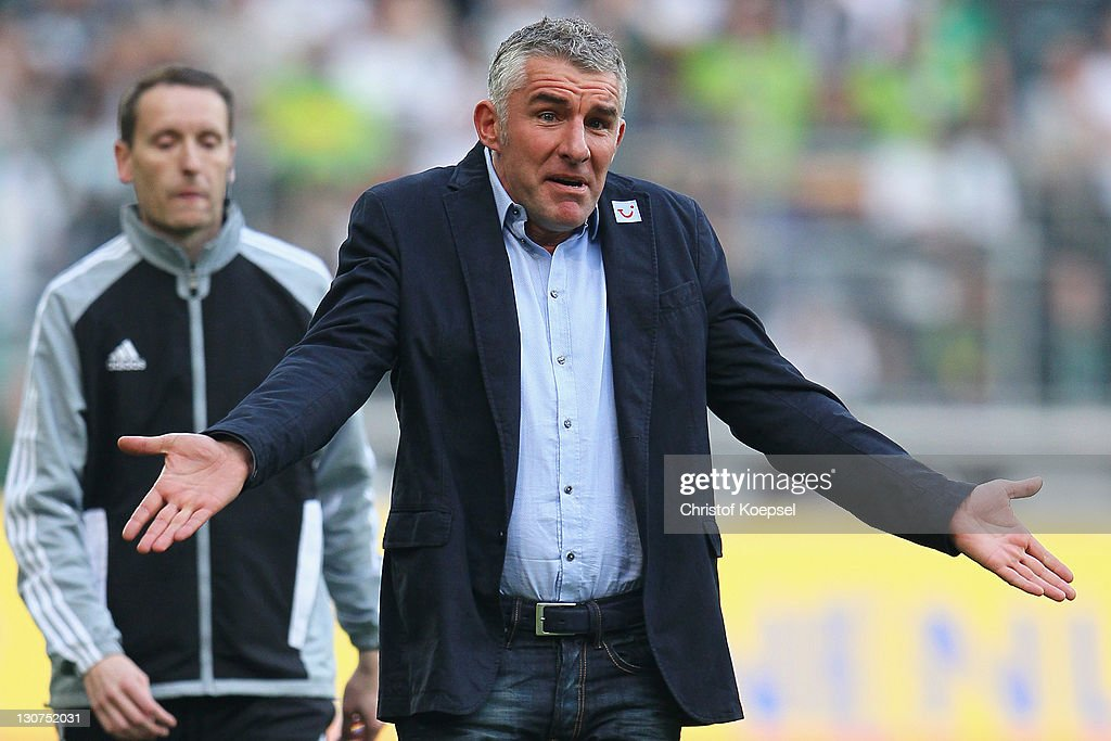 Head coach <a gi-track='captionPersonalityLinkClicked' href=/galleries/search?phrase=Mirko+Slomka&family=editorial&specificpeople=874525 ng-click='$event.stopPropagation()'>Mirko Slomka</a> of Hannover looks dejected during the Bundesliga match between Borussia Moenchengladbach and Hannover 96 at Borussia Park Stadium on October 29, 2011 in Moenchengladbach, Germany.