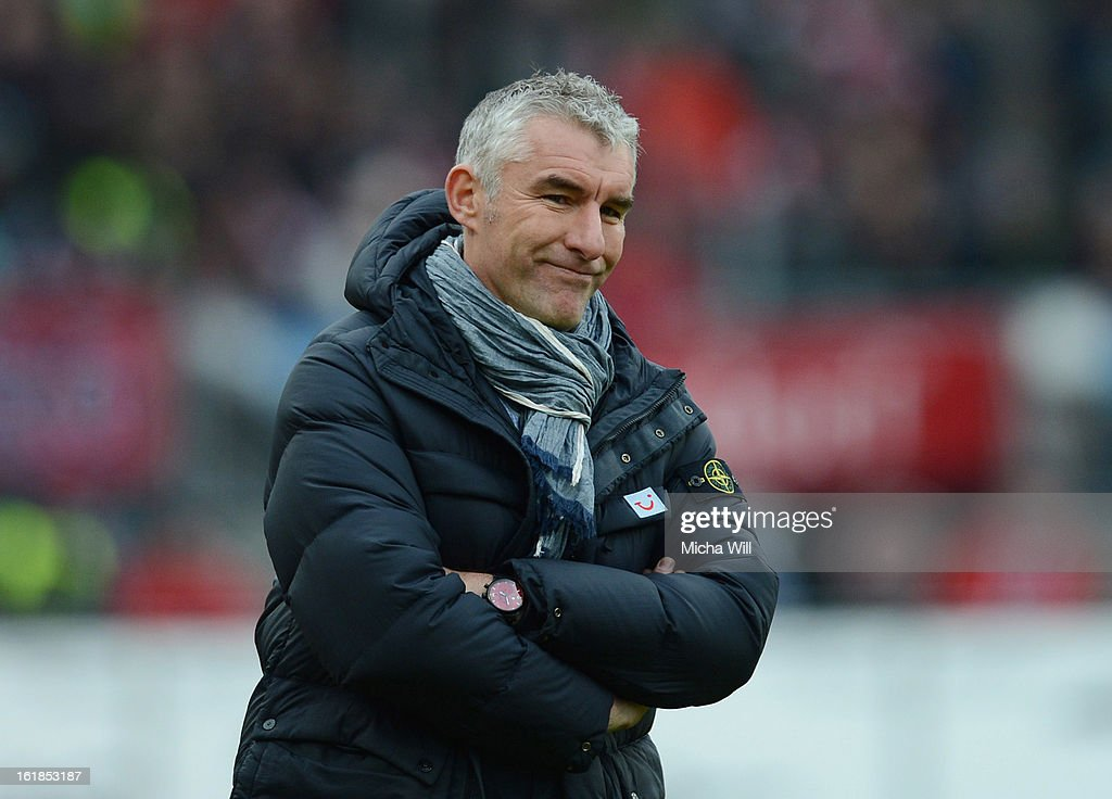 Head coach <a gi-track='captionPersonalityLinkClicked' href=/galleries/search?phrase=Mirko+Slomka&family=editorial&specificpeople=874525 ng-click='$event.stopPropagation()'>Mirko Slomka</a> of Hannover reacts during the Bundesliga match between 1. FC Nuernberg and Hannover 96 at Grundig-Stadion on February 17, 2013 in Nuremberg, Germany.