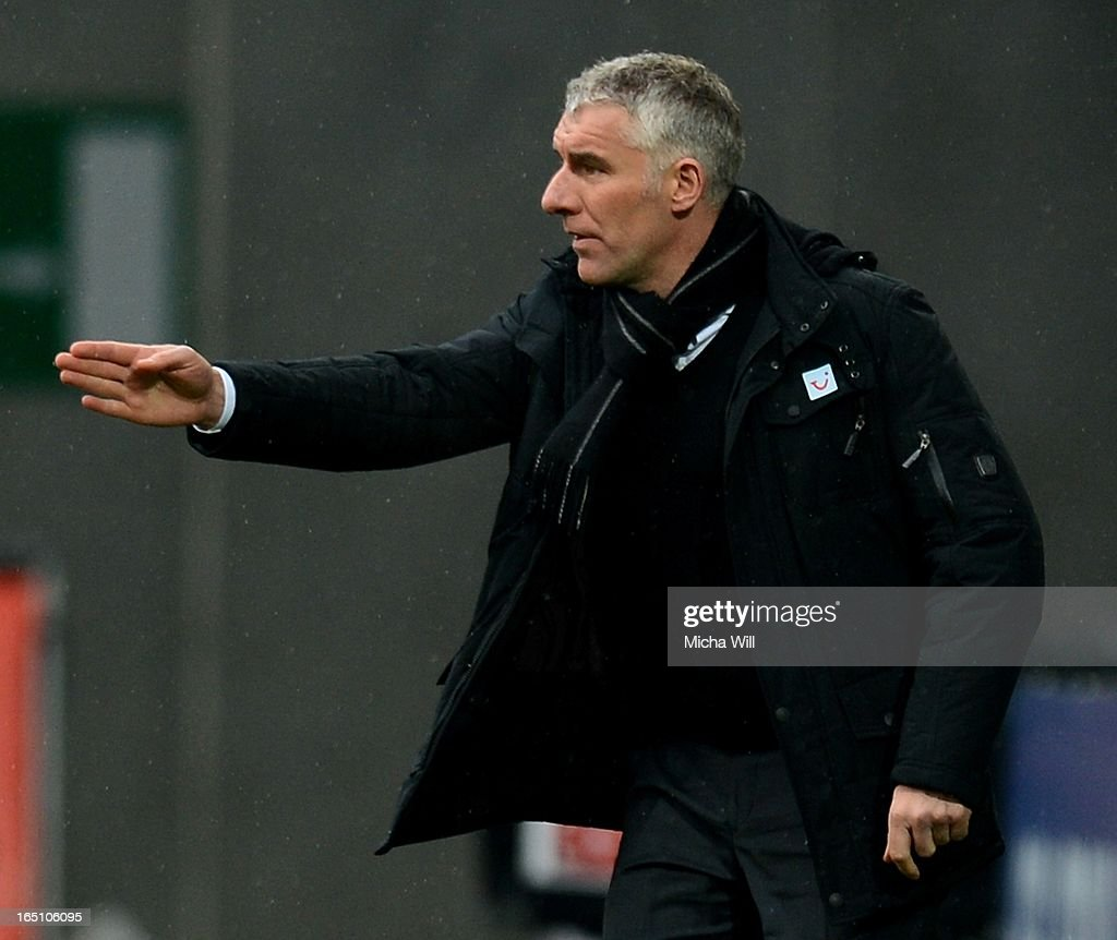 head coach <a gi-track='captionPersonalityLinkClicked' href=/galleries/search?phrase=Mirko+Slomka&family=editorial&specificpeople=874525 ng-click='$event.stopPropagation()'>Mirko Slomka</a> of Hannover reacts during the Bundesliga match between FC Augsburg and Hannover 96 at SGL Arena on March 30, 2013 in Augsburg, Germany.