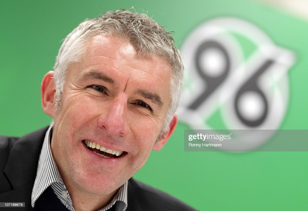 Head coach <a gi-track='captionPersonalityLinkClicked' href=/galleries/search?phrase=Mirko+Slomka&family=editorial&specificpeople=874525 ng-click='$event.stopPropagation()'>Mirko Slomka</a> of Hannover smiles after the Bundesliga match between Hannover 96 and SC Freiburg at AWD Arena on November 27, 2010 in Hanover, Germany.